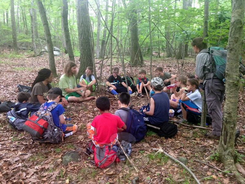 One group of 7- to 9-year-old campers discussed which of their four campsites they wanted to use for their shelter on Tuesday, July 7, the second day of the Two Coyotes Wilderness School's Forts and Shelters camp. (Gallagher photo)