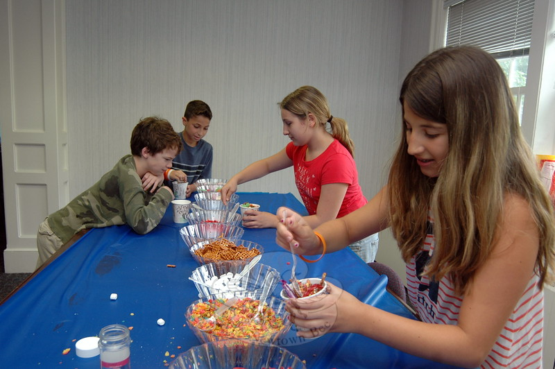 From left clockwise, Thomas Simms, Lorenzo Biasetti, Carolanne Scinto, and Vanessa Ba-jraliu gathered candies and snacks to decorate their Cupcake Wars entries. (Fimmano photo)