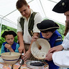 AJ Zatulskis pours out blueberries with help from docents Mike Asselta, right, Erik Benson, left and Julia Wologodzew and Jeffery Hanna. (Bobowick photo)