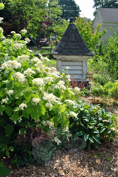 A cupula that was part of the original 1940s Dutch Colonial house became a garden ornament when the Floros family added onto the home, ten years ago. (Crevier photo)