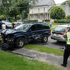 A serious three-vehicle accident occurred at the intersection of Church Hill Road and The Boulevard about 1:05 pm on July 13, sending two people to the hospital for treatment of injuries, police said. Al-though the junction is considered a three-way intersection, a commercial driveway lying directly across Church Hill Road from The Boulevard effectively results in the location functioning as a four-way in-tersection. The motorists involved in the accident were Anna Maher, 67, of 17 Papoose Hill Road, who was driving a 2009 Volkswagen Touareg SUV; Eve Kroha, 21, of 35 Moccasin Trail, who was driving a 2000 Subaru Outback station wagon; and Douglas Filter, 65, of 4 Butternut Ridge, who was driving a 2000 Jeep Grand Cherokee SUV, police said. Police said that the Volkswagen was attempting to drive from the commercial driveway at 30 Church Hill Road to The Boulevard, while the other two vehicles were traveling in opposite directions on Church Hill Road when the collision occurred. The Newtown Volunteer Ambulance Corps transported Douglas Filter and Jeep passenger Georgia Filter, age 3, to Danbury Hospital for treatment of injuries, police said. Hook & Ladder volunteer firefighters responded to the scene. The incident is under investigation, according to police. (Gorosko photo)