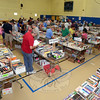 It did not take long for crowds that had gathered ahead of Saturday morning's opening to flood the Reed School gym, many zeroing in on their favorite genres as the curtains went up on the 39th Annual Friends of the C.H. Booth Library Book Sale. (Voket photo)