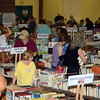 Early shoppers at the 39th Friends of the C.H. Booth Library Annual Book Sale mined the wealth of book selections in the RIS cafetorium Saturday morning. (Voket photo)