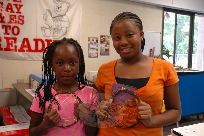 """Morgan Beaty, left, and Dallas Alexander held up dream catchers they recently created in the SMART Camp """"The Science of Nature Through Art"""" class. (Hallabeck photo)"""