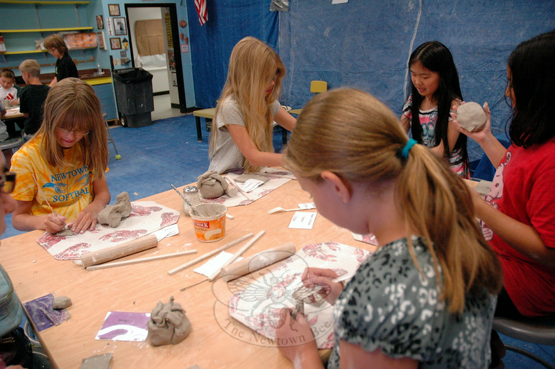 "Students in the ""Great Clay Adventure,"" offered through Newtown Continuing Education's SMART (Summer Music and Arts) Camp, class worked on Wednesday, July 9. (Hallabeck photo)"