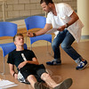 Oberon (Clarke Thorell) stands over Demetrius (Kyle Mangold) during a rehearsal of  A ROCKIN' Midsummer Night's Dream at Newtown High School July 15. The world premiere of the newly developed musical will be presented by The 12.14 Foundation in early August featuring dozens of Newtown actors and stage hands. (Voket photo)