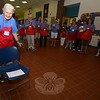 "Longtime Friend of the C.H. Booth Library Carm O'Neil was honored by nearly 100 fellow volunteers just minutes before the annual book sale opening on Saturday with the gift of a new cane, and a song adapted by Denise Kaiser based on the popular Broadway melody ""My Favorite Things."" (Voket photo)"