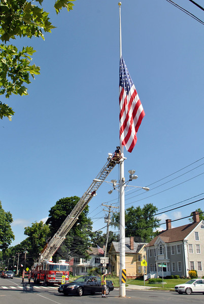 Hook & Ladder firefighters lowered the flag on Main Street to half-staff on July 20, to honor five servicemen killed last week in a shooting incident in Tennessee. A 24-year-old male opened fire at a military recruiting office and a Navy-Marine operations center a few miles apart from each other in Chattanooga on July 16, killing four Marines at that time. A US Navy petty officer who was wounded in the attack died from his injuries on Saturday. Flags are to be left down until sunset Saturday, July 25, according to a proclamation from President Obama. (Hicks photo)
