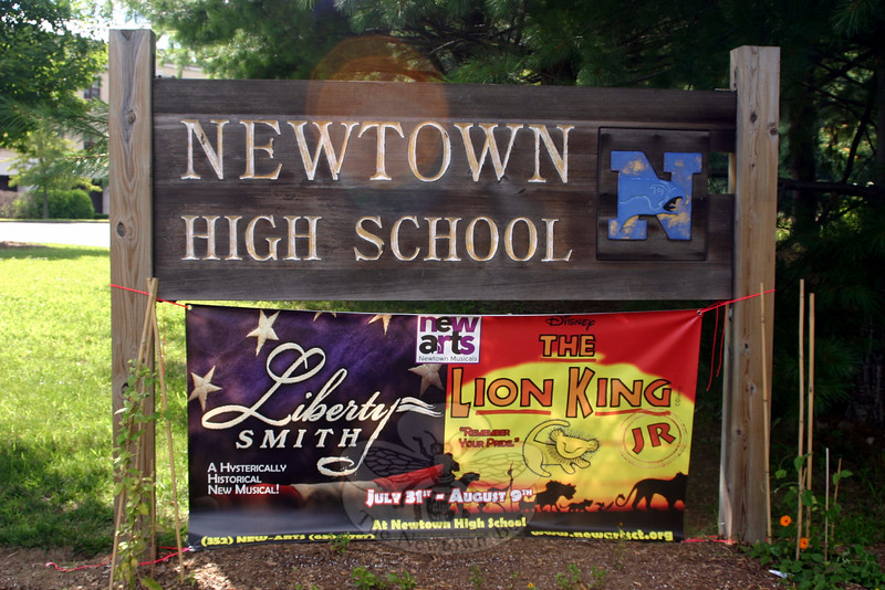 Opening night for Liberty Smith, a comedic historical musical being staged at Newtown High School, is July 31, while opening night for Disney's The Lion King Jr is the following Friday night. A banner affixed to the lower part of the NHS sign at 12 Berkshire Road has been reminding passersby of the upcoming productions. More than four dozen young cast members from the region will be featured in Liberty Smith, the first of two shows being presented this summer by NewArts, which operates under The 12.14 Foundation umbrella. Performances will be staged Friday, July 31, at 7 pm; Saturday, August 1, at 2 and 7 pm; and Sunday, August 2, at 2 pm. Originally planned for 90 actors, the production of Lion King Jr has pulled in 120-plus actors who are getting ready for six performances: Thursday and Friday, August 6–7, at 7 pm; Saturday, August 8, at 2 and 7 pm; and Sunday, August 9, at noon and 5 pm. Tickets for all shows range from $15 to $25, and can be reserved at 1214foundation.org. Additional information is available by calling 352-NEW-ARTS (352-639-2787). (Hicks photo)