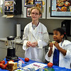 """Sampling the ingredients was harder to resist for some than others, as 8-year-old Abigail Harrington, right, demonstrates, while she and Juliana Battaglia prepare the gazpacho soup recipe for the daily """"Food TV"""" show at the Fresh and Fun Summer Cooking Class, sponsored by Newtown Parks and Recreation. (Crevier photo)"""