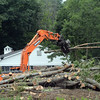 Workers this week used heavy equipment to manipulate cut trees at 168-170 Mt Pleasant Road, where construction of a medical office building is planned. (Gorosko photo)