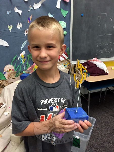 SMART camper Stephen Sibley held a fish he created in the Fused Glass class on Friday, July 17, during the first session of SMART's Showcase of the Arts. (Hallabeck photo)