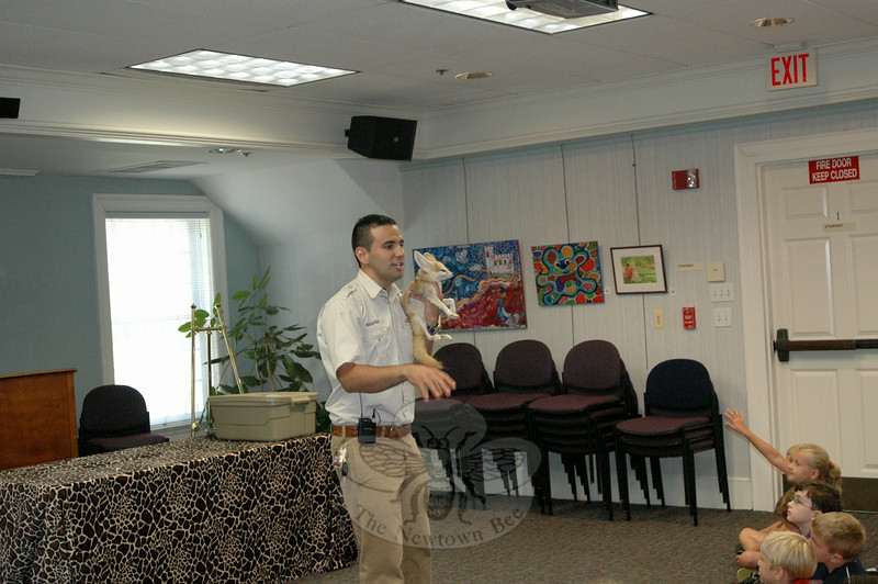 """""""Nature Nick"""" Jacinto introduced Tinker Bell, the African fennec fox, to his audience Friday, July 18, at the C.H. Booth Library. (Gaston photo)"""