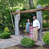 Howard Lasher and two of his friends, Emma and Sara, stand next to the moon door at the entrance to Ida's Garden, a memorial to his mother. (Crevier photo)