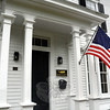 A US flag flies at the front door of the Whalen House at 65 Main Street, near the intersection of Main Street, Hanover Road and Schoolhouse Hill Road. (Gorosko photo)