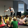 Magician Scott James, center, performed for local children on Tuesday, June 23, for C.H. Booth Library's kickoff for its Summer Reading Program. (Fimmano photo)