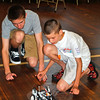 Newtown High School junior Max Minor, left, and mentee Daniel Sibley, 11, give their Battlebot a trial run, before heading over to the circle for competition. (Crevier photo)