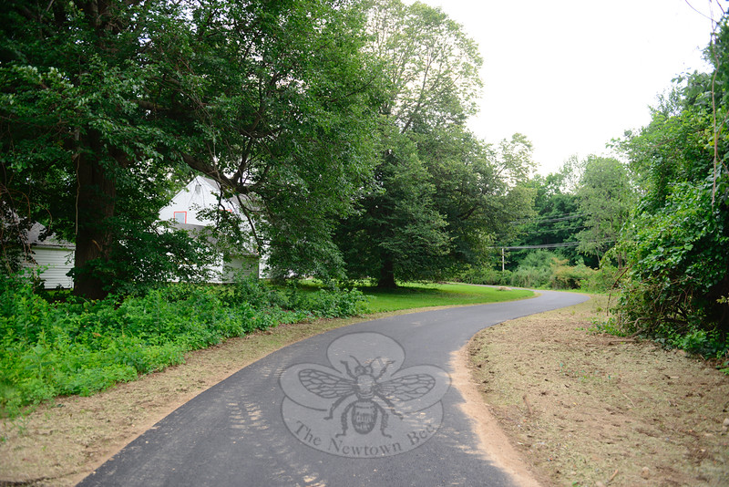 A new length of paved walkway adds to ADA-accessible existing trails leading residents through Fairfield Hills. The new, nearly mile-long section meanders, in part, past former state hospital staff housing visible from Mile Hill South near its intersection with Wasserman Way. (Bobowick photo)