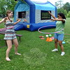 Anna Pinckney, left, and Sophia Spraggins, right, played with hula-hoop's during FUN's end of the year celebration at Dickinson Memorial Park on Sunday, June 14. (Hallabeck photo)