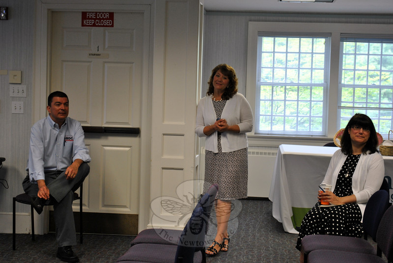 SBDC advisor Nelson Merchan,  Betsy Paynter, Newtown Economic Development Commission, and C.H. Booth Library Director Brenda McKinley (seated) take questions from attendees. (Crevier photo)