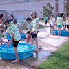 """Reed Intermediate School students participated in the school's Field Day on Friday, June 12. Classes rotated between different stations, both inside and outside the school, during the event. At kiddy pools, shown, stationed near the school, student dunk their toes in water to feel for """"gold,"""" which they had to pick up with their toes and drop in cups held by fellow classmates. At another station, students participated in a tug-of-war, and inside the school's gymnasium students played volleyball."""