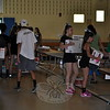 Volunteers set up 225 tables in the gymnasium, cafetorium, and other rooms at Reed Intermediate School, Tuesday, June 30, in preparation for the Friends of the C.H. Booth Library 40th Annual Book Sale, which begins July 11. Even more volunteers planned to carry on next week, setting up the books in each of the 90 categories, many of them alphabetized. Members of the Newtown High School cheer-leaders, football team, and girls' soccer teams, as well as many other young people from the area, load boxes onto dollies, and heft them onto tabletops. (Crevier photo)