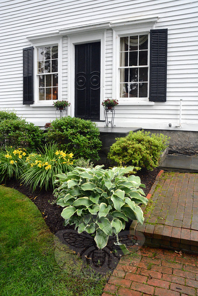 A variety of ornamental plants adorn the south side of the Whalen House, which was a stop on the 19th Annual Newtown Historical Society House & Garden Tour last weekend. (Gorosko photo)