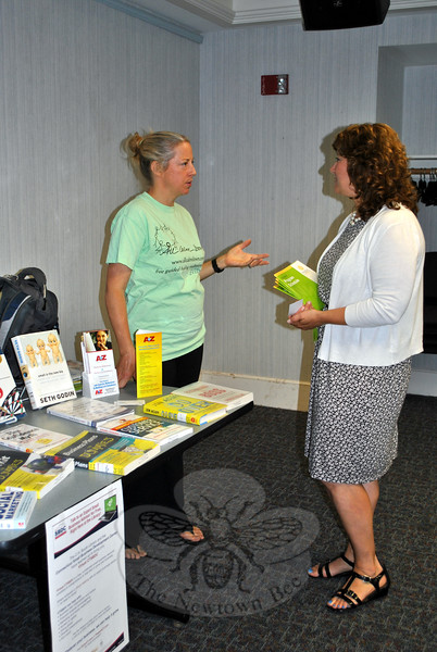 Carla Barzetti, left, speaks with Betsy Paynter of the Newtown EDC, following the launching of the new Virtual SBDC Center at the C.H. Booth Library, Tuesday, June 23. (Crevier photo)