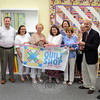 First Selectman Pat Llodra recently joined Economic Development and Newtown Chamber of Commerce representatives for a ribbon cutting at The Quilt Shop By Lois, located in the new commercial building at 12 Queen Street. Among those gathered for the festivities are, from left, Robert Mitchell, chamber representative Angelo Marini, Diane Quimby, Mrs Llodra, owner Lois Mitchell, Yvonne Berrios, Amy Trumpeter, Sandy Barber, building owner Dr Curtis Beck and EDC Commissioner Matt Mihalcik.  (Bee Photo, Voket)