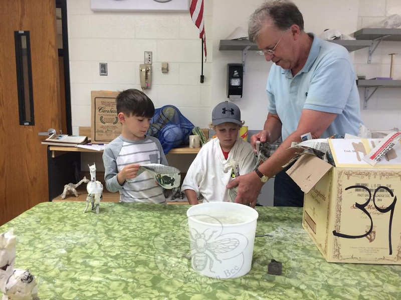From left, Newtown Parks and Recreation's Drawing and Mixed Media campers Rafe D'Agostino and Jimmy Ballard watch as instructor Chuck Fulkerson demonstrated papier mâché techniques on Wednesday, July 15.  (Bee Photo, Fimmano)