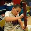 SMART camper Anthony Crisci worked to create a tree sculpture in the Constructivism 2 class. The sculpture would eventually include a snake spiraling around the tree.  (Bee Photo, Hallabeck)