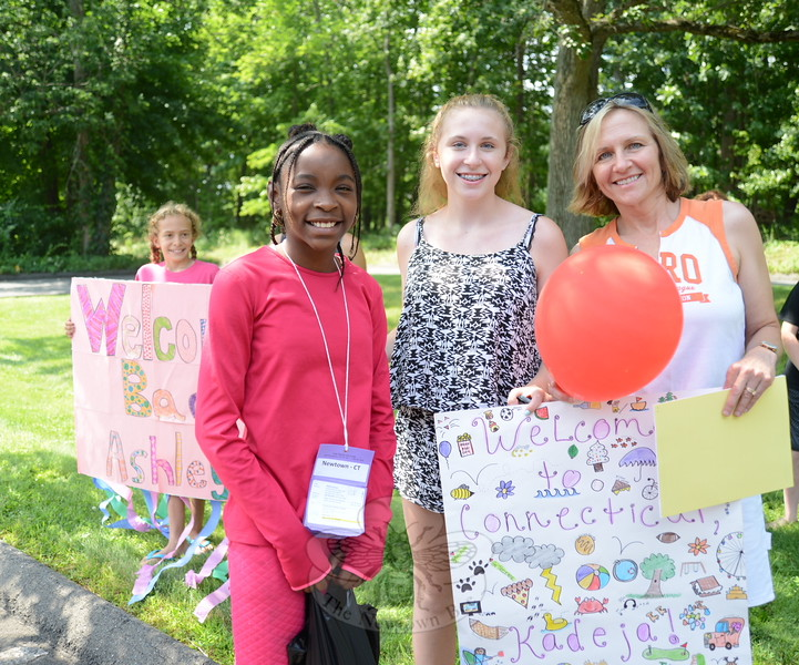 Fresh Air guest Kadeja Johnson meets Bonnie, center, and Fran Trelease, right, on Monday after stepping off the bus that brought her and others to Connecticut from New York City. She will be visiting this week with the Oxford family.  (Bee Photo, Bobowick)