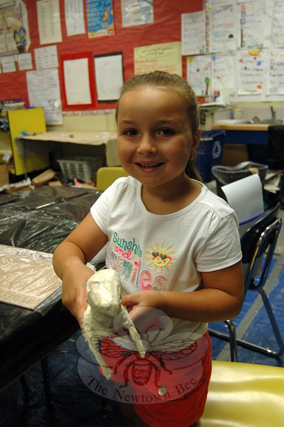 SMART camper Emily Weight worked on creating a papier mâché dog during a class on Friday.  (Bee Photo, Hallabeck)