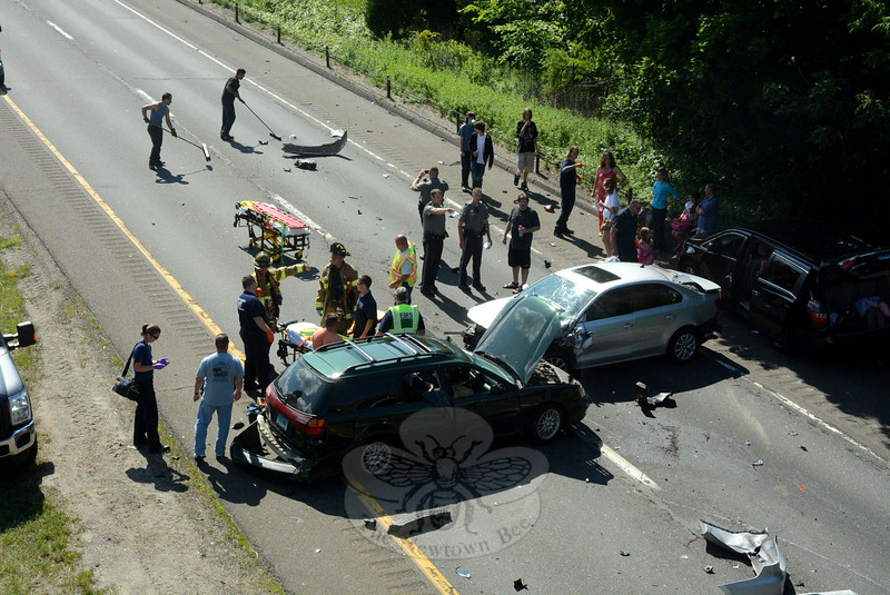 Many state police, volunteer firefighters, ambulance staffers, and wrecker crews responded to a five-vehicle accident on westbound Interstate 84, near the Tunnel Road overpass, at about 3:47 pm on Friday, June 27. The accident, which sent three drivers to the hospital for treatment of injuries, resulted in lengthy travel delays on the highway. (Gorosko photo)
