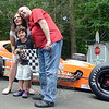 Henri Quirk got a big and loud surprise on his 5th birthday when Stephen Kopcik from Newtown's NJK Automotive tooled up in his bright orange race car. It was Henri's special wish to get a race car as a gift, but he probably did not expect one he could actually sit in — as evidenced by the shock and joy he shared with guest Ty Palladino when it pulled into his driveway June 21. Christopher and Sioux, his mom and dad, also looked like they were enjoying having such an unusual guest at their Botsford residence. (Voket photo)
