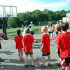 Students lined up to test their aim at a basketball station during St Rose of Lima School's field day. (Hallabeck photo)