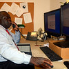 New Director of Information Technology Al Miles works at his desk in the Newtown Municipal Center. Mr Miles, a Newtown resident, was selected after a months-long search that involved identifying and narrowing the candidate field from a pool of eight finalists, according to town officials involved in the executive search. (Voket photo)