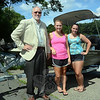 From left, George Benson, town director of planning and land use; Sara Benson, and Samantha Wysocki are seen at Taunton Lake on June 26 after the two women had spent the day on the lake recording the locations and density of its infestation with the weed known as aquatic milfoil. The weed study being conducted by the Connecticut Agricultural Experiment Station is intended to provide guidance on how best to control the nuisance vegetation in the 124-acre lake. (Gorosko photo)