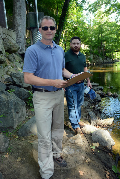 Rob Sibley, town deputy director of planning and land use, foreground, and Steve Maguire, town land use enforcement officer, took some water samples at the Pootatuck River in Sandy Hook Center, just upstream of the Church Hill Road vehicular bridge on the morning of June 27. It was one of 20 local sites where the men would collect water samples that day. The town and the Pootatuck Watershed Association have been testing local water quality since 2006 to gauge environmental conditions and spot any changes. The project provides a land-use planning tool aimed at ensuring that future land development is done in an environmentally sound manner. (Gorosko photo)