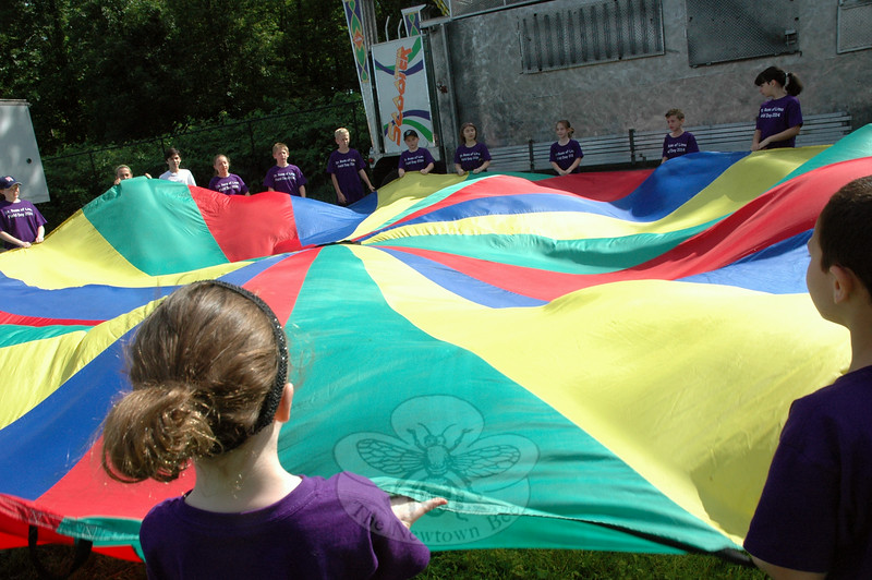 At a station for St Rose of Lima School's field day, students played with a parachute. (Hallabeck photo)