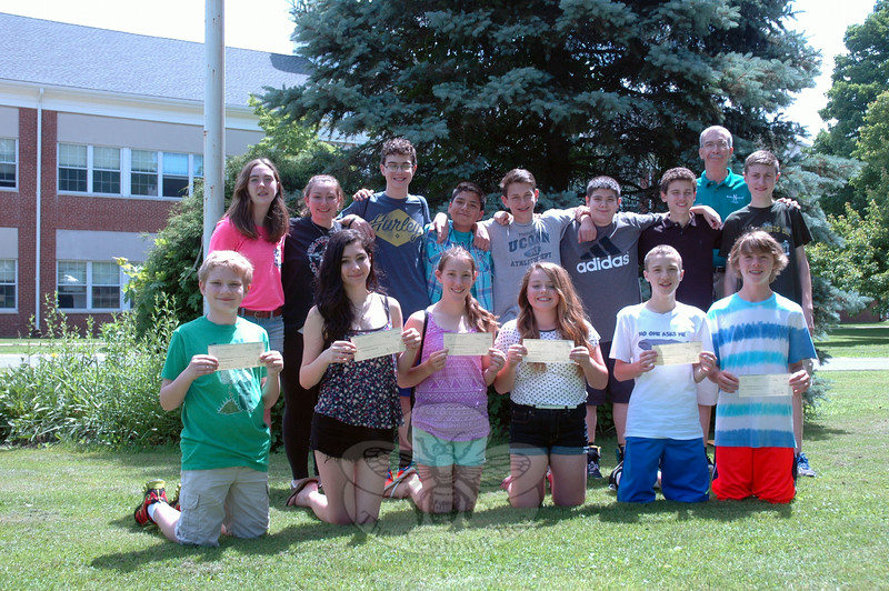 Newtown Middle School Interact Club students posed on Wednesday, June 18, with checks that will be sent to foundations in honor of the children who lost their lives on 12/14. (Hallabeck photo)