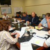 Newtown Emergency Management Director and Fire Marshal William Halstead, lower right, is joined by a group of town officials during Governor Dannel P. Malloy's briefing June 23 as the state conducted an emergency preparedness drill simulating response to a Category 1 hurricane. Following the drill, local officials issued updated information to residents to help them better respond if the community is threatened by a dangerous storm or other disaster. (Voket photo)