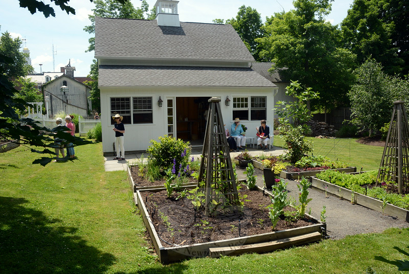Well-organized gardens are situated next to a garage/utility building in the rear yard at 53 Main Street, behind the early 19th Century Boyle-Poirier residence. (Gorosko photo)