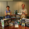 The Friends of Booth Library have received nearly twice as many CD and DVDs for this year's Annual Book Sale than last year. Eleanor Zolov and Jim Maher, who specialize in electronic media for the book sale, show off a small selection of the more than 7,000 CDs and 1,500-plus DVDs that will be offered July 12–16 at Reed School. (Hicks photo)