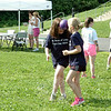 "Maddie Watson, left, and Jennifer Demassa participated in the ""Coconut Relay"" during St Rose of Lima School's field day, held Monday, June 16. (Hallabeck photo)"