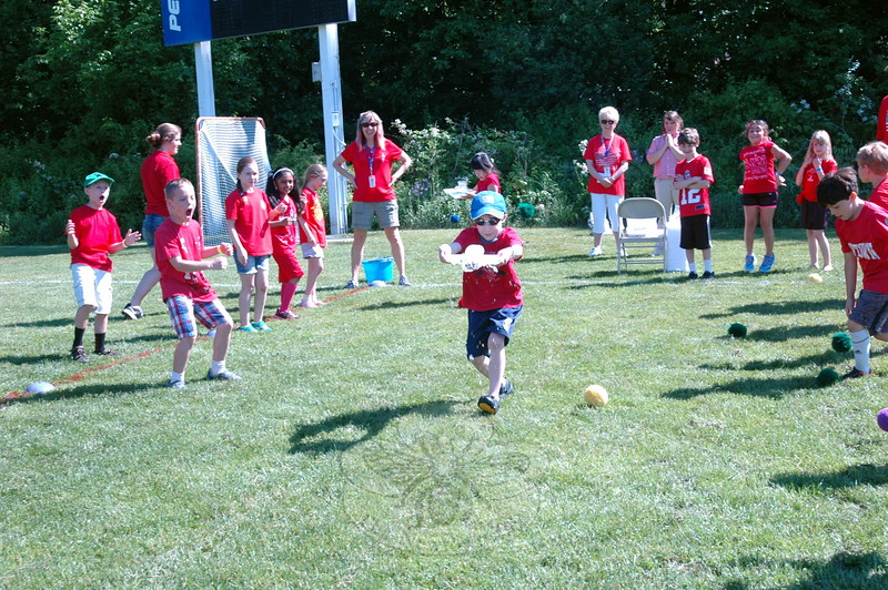 Hawley Elementary School student Ryan Michlovitz tried his best to carry a cup filled with water at the Waiters Carry station during his school's Field Day, held last Friday. (Hallabeck photo)