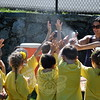 Staying hydrated was the word for the day at HOM Spirit Day, last Friday morning. Parent volunteer Kimberly Bragoli spritzes a group of first grade students, to their delight. (Crevier photo)