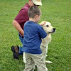 Patrick Leddy, 4, pets Newtown Strong therapy dog, Sundance, under direction of handler Joe Cusimano. (Crevier photo)