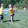 Hawley Elementary School students Sam Kirshner, left, and Piper Feli participated in a Beach Ball Relay station during Hawley Elementary School's Field Day, held on Friday, May 29. The station challenged participants to hold hands while not touching a beach ball, which was snuggled between the participants while they raced. (Hallabeck photo)