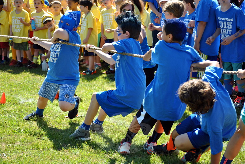 "Fourth grade students from the Blue Team give it their all during one of several energetic ""Spirit Tugs"" at Head O' Meadow School. (Crevier photo)"